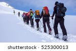 a group of backcountry skiers... | Shutterstock . vector #525300013