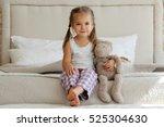cute little girl in pajama... | Shutterstock . vector #525304630