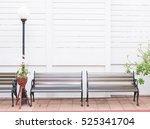 outdoor patio with empty chair | Shutterstock . vector #525341704