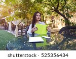 gorgeous young woman is reading ... | Shutterstock . vector #525356434