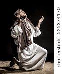 jesus christ praying to god...   Shutterstock . vector #525374170