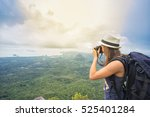 hiker with camera and backpack... | Shutterstock . vector #525401284