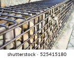 stones in metal wire cage  ... | Shutterstock . vector #525415180