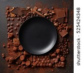 frame of chocolates with plate | Shutterstock . vector #525424348