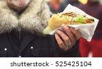 sandwich in the man s hands....