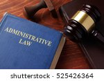 Small photo of Book with title administrative law on a table.