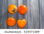 persimmons on wooden background ... | Shutterstock . vector #525471589