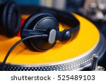 dj headphones on turntables in... | Shutterstock . vector #525489103