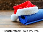 close up of blue mat with santa ... | Shutterstock . vector #525492796
