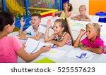 primary school kids sitting at... | Shutterstock . vector #525557623