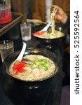 Small photo of Eating ramen noodles called Yatai at mobile food stall in Fukuoka, Kyushu, Japan