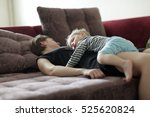 sleeping mother and boy on a... | Shutterstock . vector #525620824