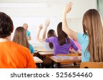 rear view of students in bright ... | Shutterstock . vector #525654460