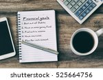 financial goals on notepad on... | Shutterstock . vector #525664756