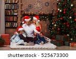 smiling family in christmas... | Shutterstock . vector #525673300