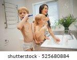 family in bathroom brushing... | Shutterstock . vector #525680884