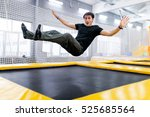 A Young Man Trampolining In Fl...