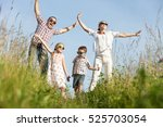 happy family walking on the... | Shutterstock . vector #525703054