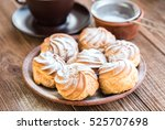delicious profiteroles with... | Shutterstock . vector #525707698