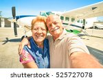 happy senior couple taking... | Shutterstock . vector #525727078