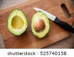 fresh avocado cut in half on a...   Shutterstock . vector #525740158
