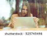 Shocked Woman Holding Computer...