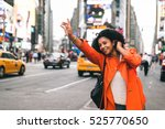 woman looking for a taxi in new ... | Shutterstock . vector #525770650