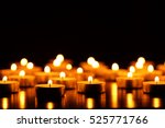 many burning candles with... | Shutterstock . vector #525771766
