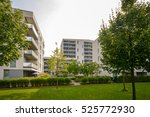 Small photo of Apartment buildings in the city - Facades of new modern residential houses in green environment