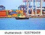 tugboat and crane in harbor...   Shutterstock . vector #525790459