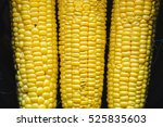 golden corn in black bowl top... | Shutterstock . vector #525835603