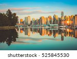 Stock photo beautiful view of vancouver skyline with famous stanley park in scenic golden evening light at 525845530