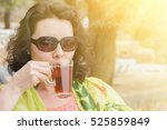 woman in sunglasses with a mug... | Shutterstock . vector #525859849