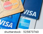 stack of credit cards with... | Shutterstock . vector #525873760