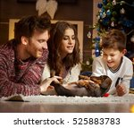 Stock photo young family caressing dachshund puppy received for christmas all smiling 525883783