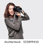 woman photographer takes images ... | Shutterstock . vector #525899410