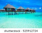 beach in maldives with few palm ... | Shutterstock . vector #525912724