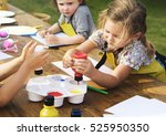 kid learning painting drawing... | Shutterstock . vector #525950350