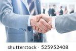 closeup of a business handshake | Shutterstock . vector #525952408
