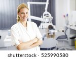 attractive female dentist... | Shutterstock . vector #525990580