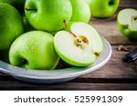 Organic green juicy apples on a ...