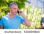 happy man talking over phone on ... | Shutterstock . vector #526004860