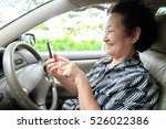 senior woman driving car and... | Shutterstock . vector #526022386