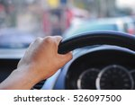 driver's hands on the steering... | Shutterstock . vector #526097500
