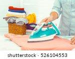 closeup of woman ironing... | Shutterstock . vector #526104553