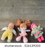 Dolls On Wooden Background. Top ...