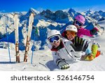 skiing family enjoying winter... | Shutterstock . vector #526146754