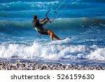 Kitesurfing. Kitesurfer Rides...