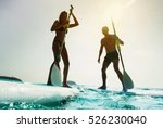 stand up paddle board couple...