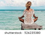 Young Woman Meditation In A...